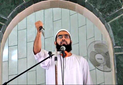 Lider religioso palestino dando un discurso cuchillo en mano